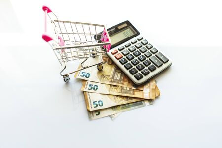 Banknotes and Calculator, Euro Banknotes on White Background, Money, Finance, Tax, Profit and Costing, 50 Euro, Euro Bills, Compound Interest Rate Calculation or Financial Investment Business Concepts