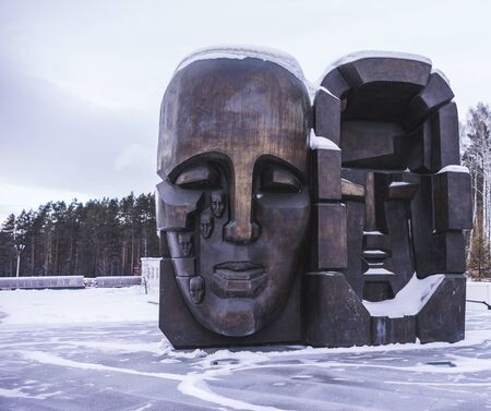 "EKATERINBURG, RUSSIA - DECEMBER 14, 2019: ""Mask of Sorrow"" Memorial to Stalin-Era Repressions in the Russian City of Yekaterinburg by Ernst Neizvestny, Its Two Weeping Faces — One Facing Europe, the Other Asia — Symbolize Repentance and Respect fo"