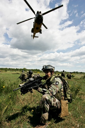 France, the training center of a foreign legion - circa, 2011. Legionnaires during training before a combat mission.
