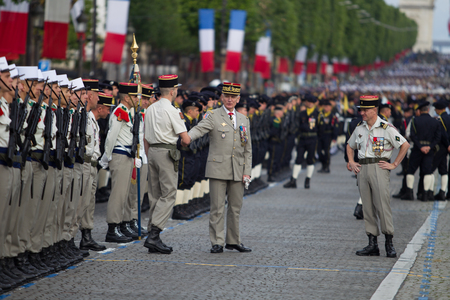 Paris, France - July 14, 2012. The Chief of Staff of the Armed Forces of the French Republic welcomes the legionaries of the French foreign legion during the parade on the Champs Elysees. Editorial