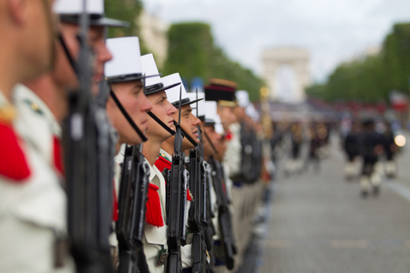 Paris. France. July 14, 2012. Rows of foreign legionaries of the French foreign legion against the background of the triumphal arch during the parade on the Champs Elysees in Paris. Editorial