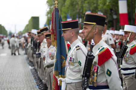 champs elysees: Paris. France. July 14, 2012. Rows of foreign legionaries of the French foreign legion with a banner during the parade on the Champs Elysees in Paris. Editorial