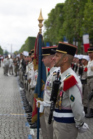 Paris. France. July 14, 2012. Rows of foreign legionaries of the French foreign legion with a banner during the parade on the Champs Elysees in Paris. Editorial