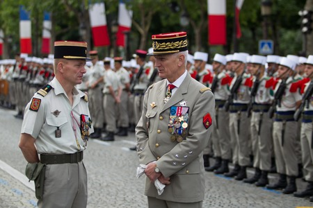 champs elysees: Paris, France - July 14, 2012. The Chief of Staff of the Armed Forces of the French Republic welcomes the legionaries of the French foreign legion during the parade on the Champs Elysees. Editorial