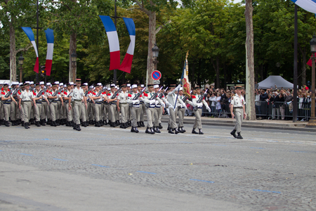 champs elysees: Paris, France - July 14, 2012. The procession of legionnaires of the French foreign legion during the military parade on the Champs Elysees in Paris.