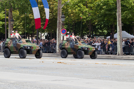 Paris, France - July 14, 2012. Procession of military equipment during the military parade on the Champs Elysees in Paris. Editorial