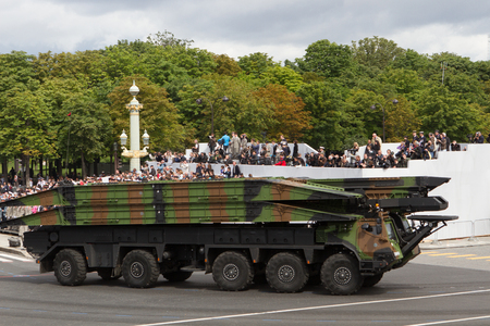 Paris, France - July 14, 2012. Procession of military equipment during the military parade in honor of the Bastille Day on the Champs Elysees in Paris. Editorial