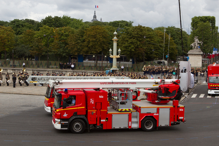 Paris, France - July 14, 2012. The procession of fire engines during the military parade in honor of the Bastille Day on the Champs Elysees in Paris.