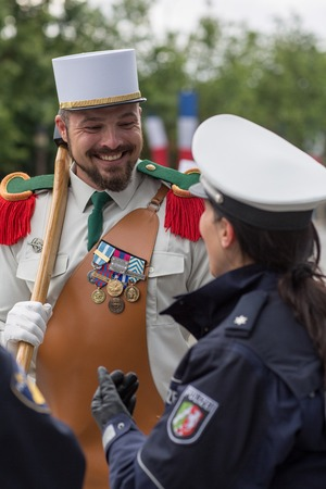 Paris. France. July 14, 2012. A legionary pioneer of the French foreign legion with representative of the police before the parade on the Champs Elysees in Paris.