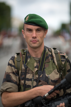 Paris, France - July 14, 2012. Legionnaire photographer of the French Foreign Legion takes part in the annual military parade in honor of the Bastille Day.