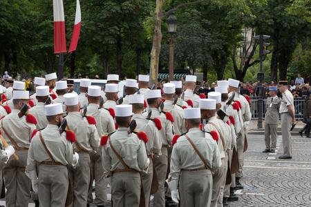 Paris, France - July 14, 2012. Soldiers from the French Foreign Legion march during the annual military parade in honor of the Bastille Day in Paris.