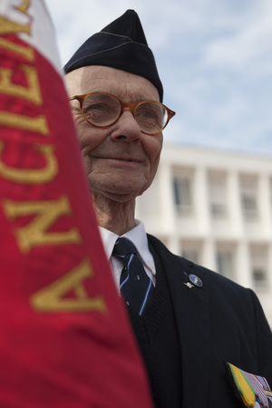 Aubagne, France. May 11, 2012. Portrait of a veteran of the French foreign legion with the banner of veterans .