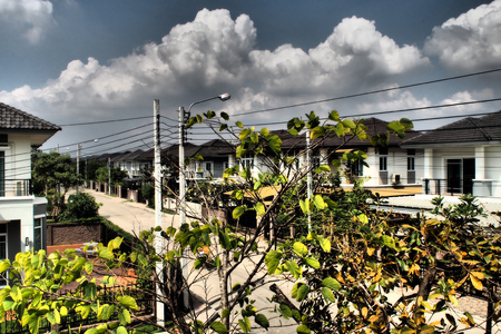 townhomes: housing development with mant plant and blue sky