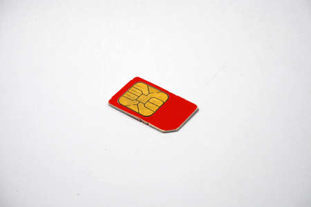 gsm phone: Red Sim card for telephone Stock Photo
