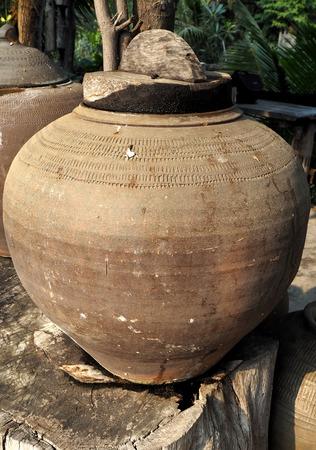 earthen: Old earthen jar in Thailand