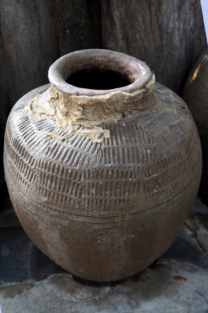 earthen: Old earthen jar in Thailand