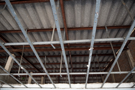 roof framing: Roof construction is hard to do Stock Photo