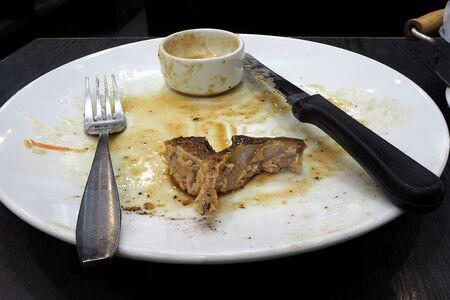 finished: finished plate with big bone Stock Photo