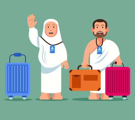 Couple pilgrims carrying whelled briefcase  ready for pilgimage trip to Mecca.