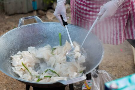 Close up handmade cooking Sweet Young Coconut Dried, Maprao Keaw thai sweets snack traditional, Chiang Khan
