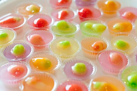 Fruit Shaped Mung Beans in Jelly close up in white foam dish, Wun Look Choup Thai sweets