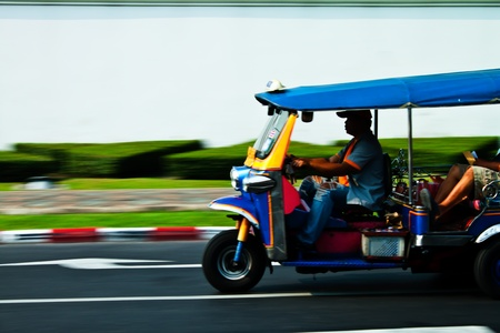 Tuk-tuk ride is on the road.