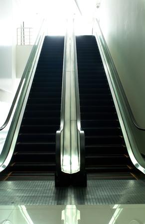 Shop escalator in shopping center photo