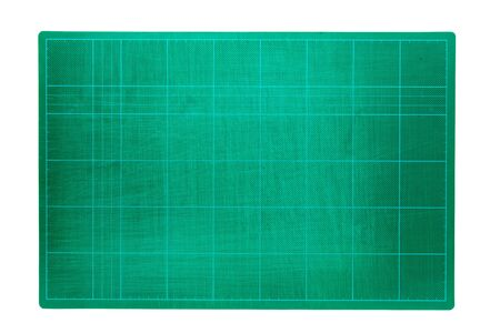 Green cutting mats on a white background. Stock Photo