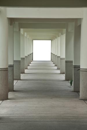 Pergola with stone columns and pavement floor. photo