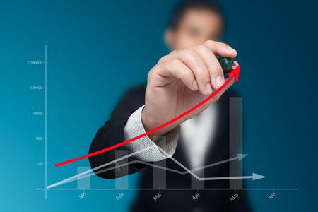 business plan: Male hand drawing a graph. Stock Photo