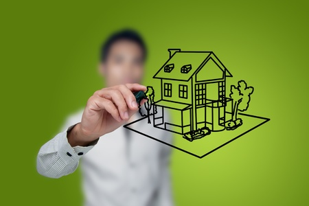 real estate background: Hand drawing house in a whiteboard. Stock Photo