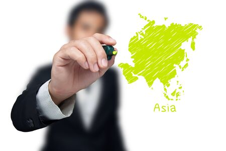 Businessman drawing a map of continent Asia. Stock Photo