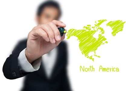 Businessman drawing a map of continent North America.