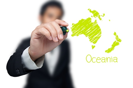 Businessman drawing a map of continent Ocenia.