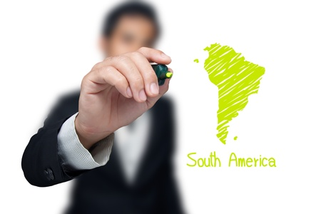 Businessman drawing a map of continent South America.