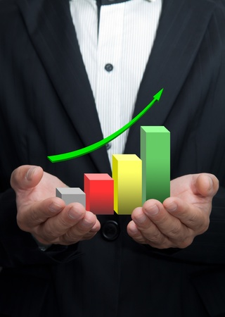 Graphs on the hands of businessmen. Stock Photo