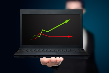laptop with business or profits growth graph. photo