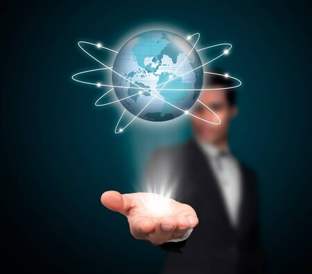 information international: Businessman with a global network. Stock Photo