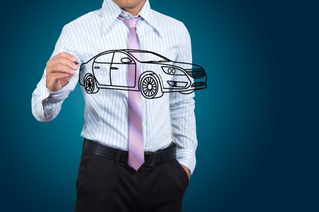 Businessman drawing car in a whiteboard. Stock Photo