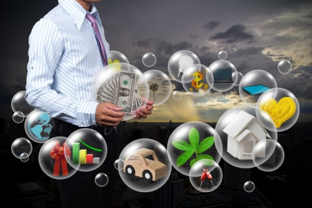 Holding a dollars in the ball in his hands