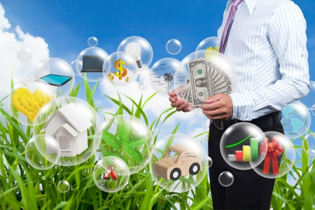 money sphere: Holding a dollars in the ball in his hands.