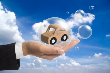 Holding a car in the balls. Stock Photo - 16208107