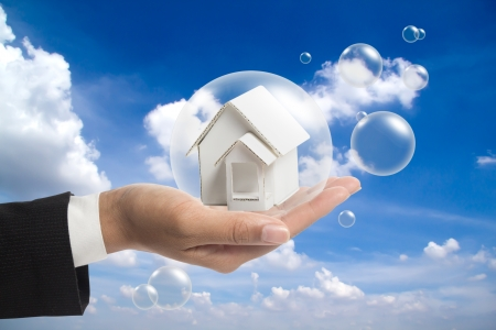 Holding white house in the balls. Stock Photo - 16208156