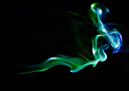Colorful smoke on the black background.