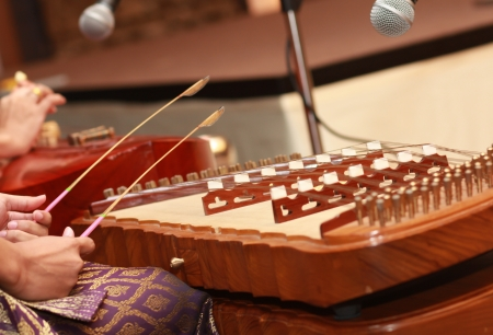 Musicians are playing the wood dulcimer. Stock Photo