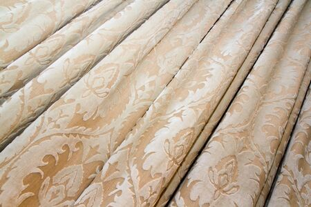 satiny: A background of drapery with pattern.