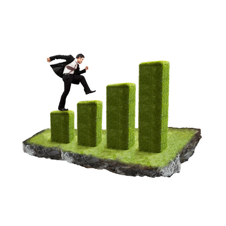 Businessman with growth chart of profits. Stock Photo