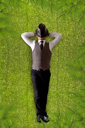 liberate: Businessman sleeping on a grass. Stock Photo