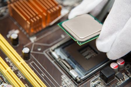 Expert engineers examining computer equipment. Stock Photo