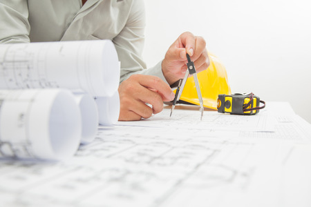 Architect sketching a construction project. photo
